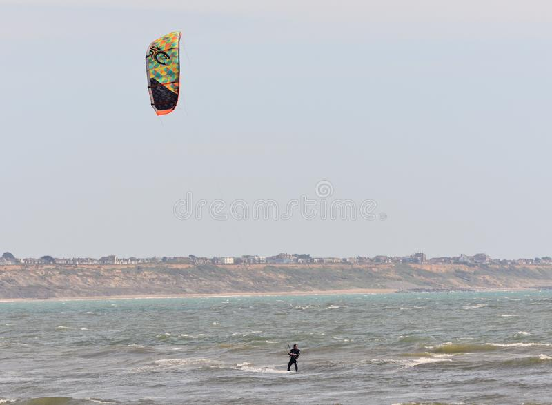 Recreational Water Sports Action. A Kiteboarder riding the waves. Dorset, UK. May 2018. royalty free stock photos