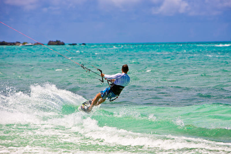 Male Kitesurfer cruising royalty free stock photography