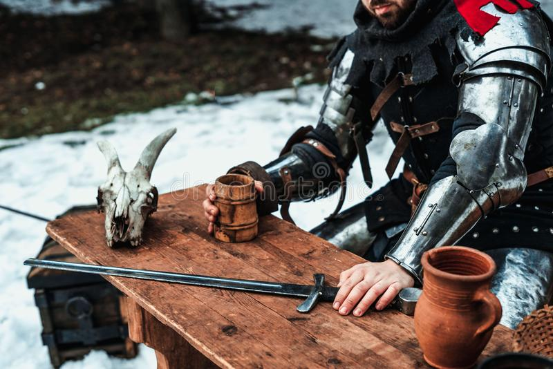 Male knight at table royalty free stock photography