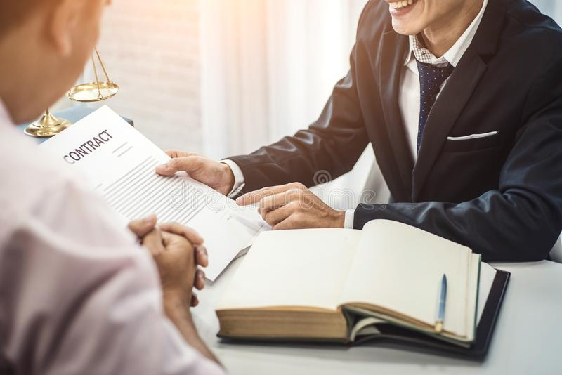 Male lawyer explain a contract agreement to client for law .Law and Legal services concept stock photos