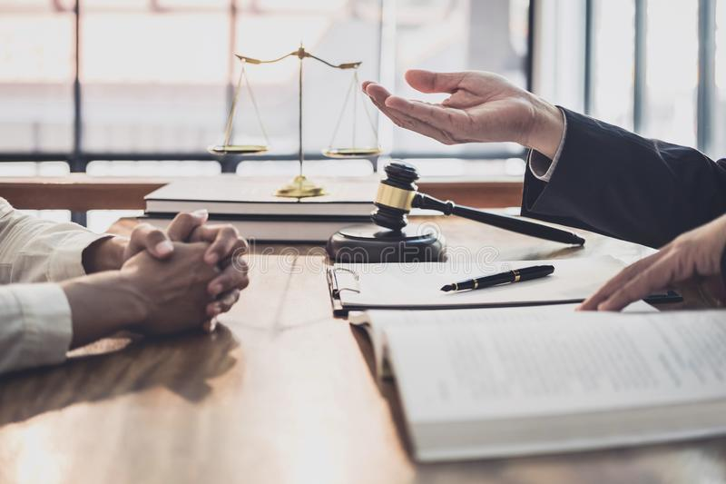 Male lawyer or judge consult having team meeting with Businesswoman client, Law and Legal services concept stock images