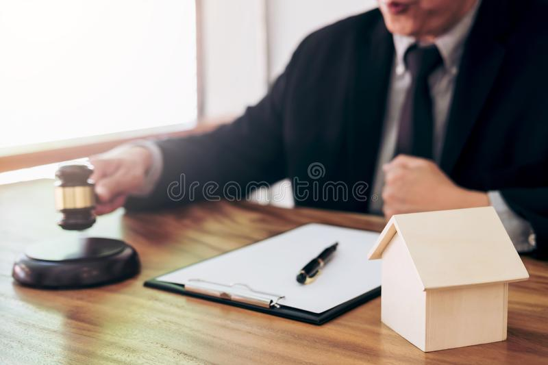 Male lawyer or judge hand`s striking the gavel on sounding block stock photos
