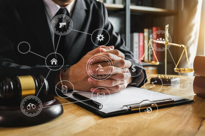 Male lawyer in the office with brass scale on wooden royalty free stock photography