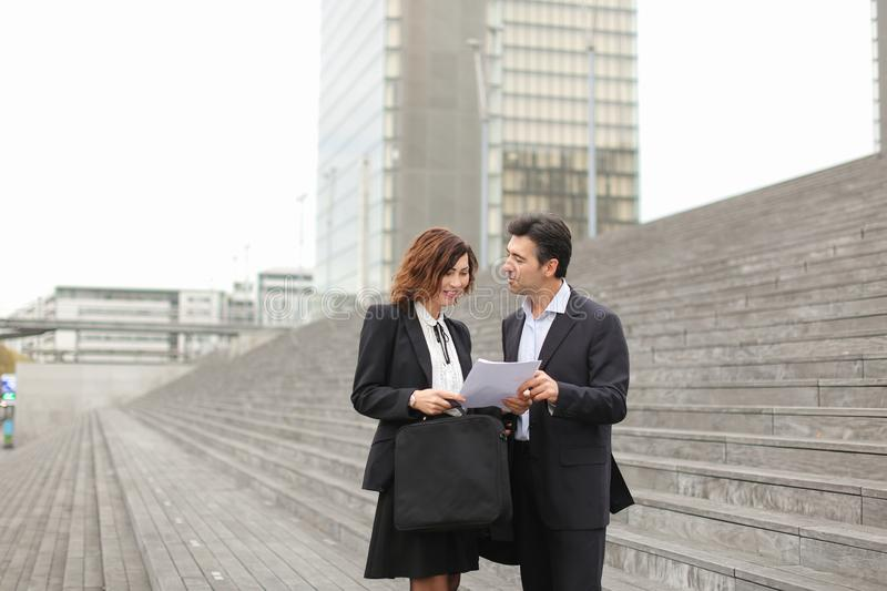 male lawyer speaking with female client. stock image