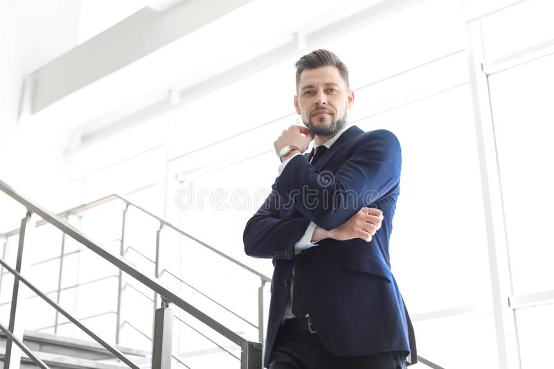 Male lawyer standing near stairs. In office stock photos