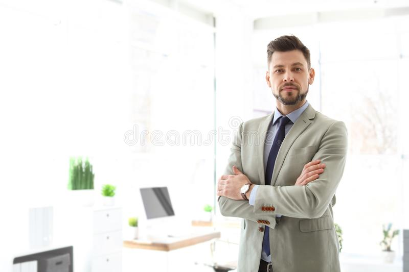 Male lawyer standing in office. Male lawyer standing in light office stock photo