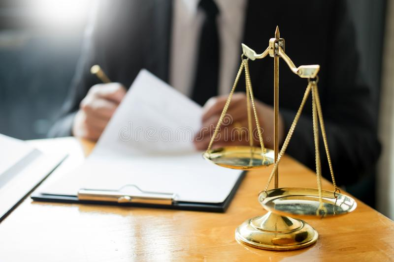 Male lawyer working with contract papers and reading law book in a courtroom, justice and law concept while presiding over trial royalty free stock photos