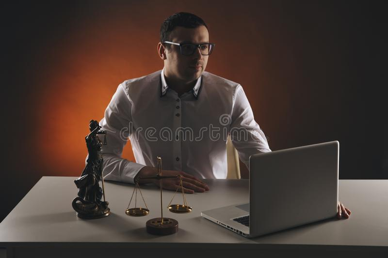 Male lawyer working with contract papers and wooden gavel on tabel in courtroom. justice and law ,attorney, court judge. Lawyer working with contract papers and royalty free stock photos