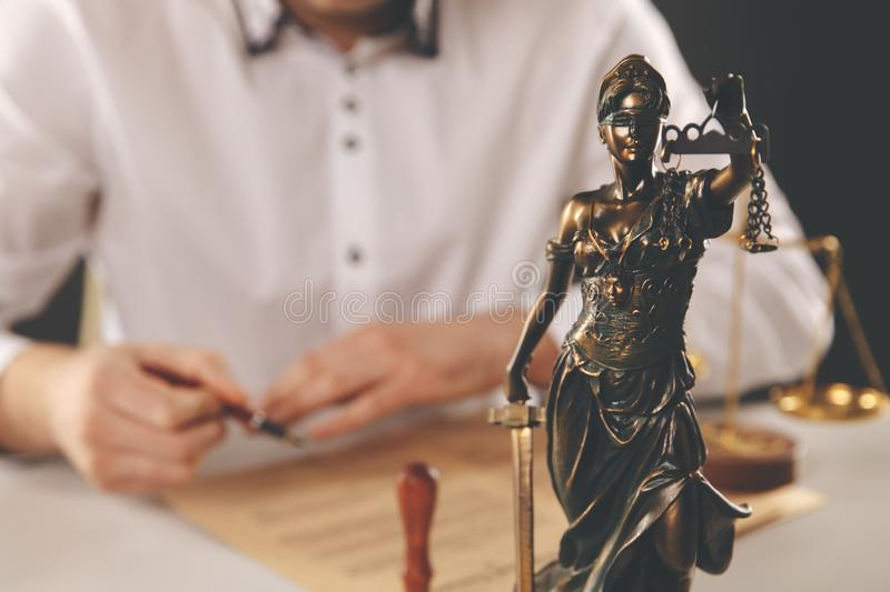 Male lawyer working with contract papers and wooden gavel on tabel in courtroom. justice and law ,attorney, court judge. Lawyer working with contract papers and stock photo