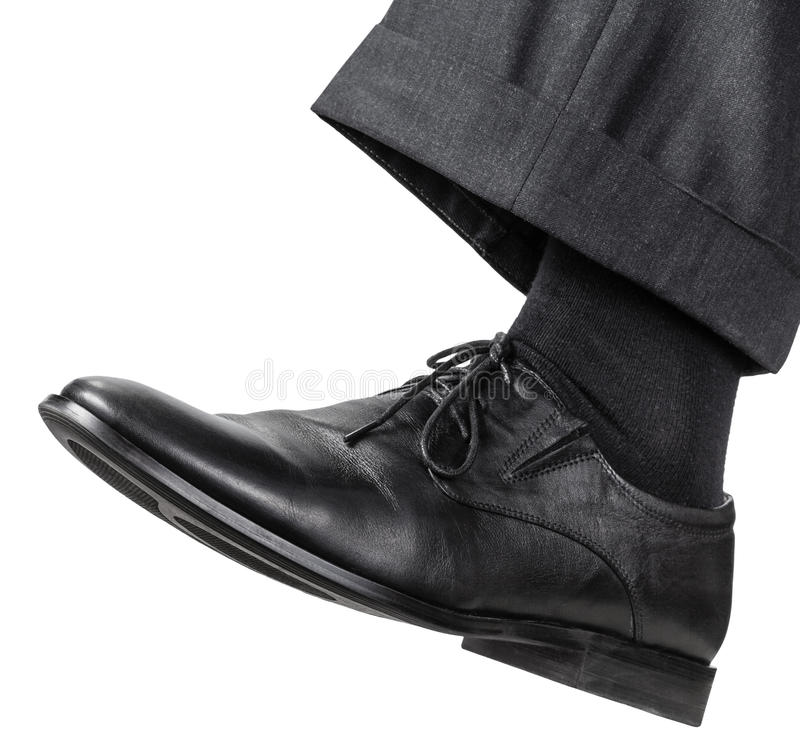 Free Male Left Foot In Black Shoe Takes A Step Royalty Free Stock Images - 65136159