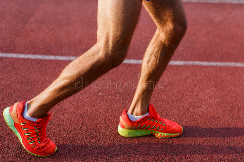 Male legs and feet on cross track outdoors royalty free stock photography