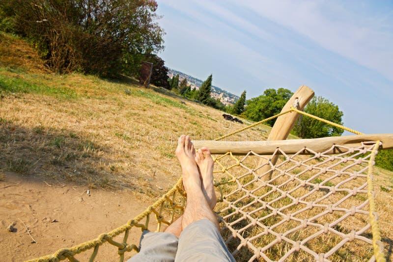 Male legs in a hammock royalty free stock photo
