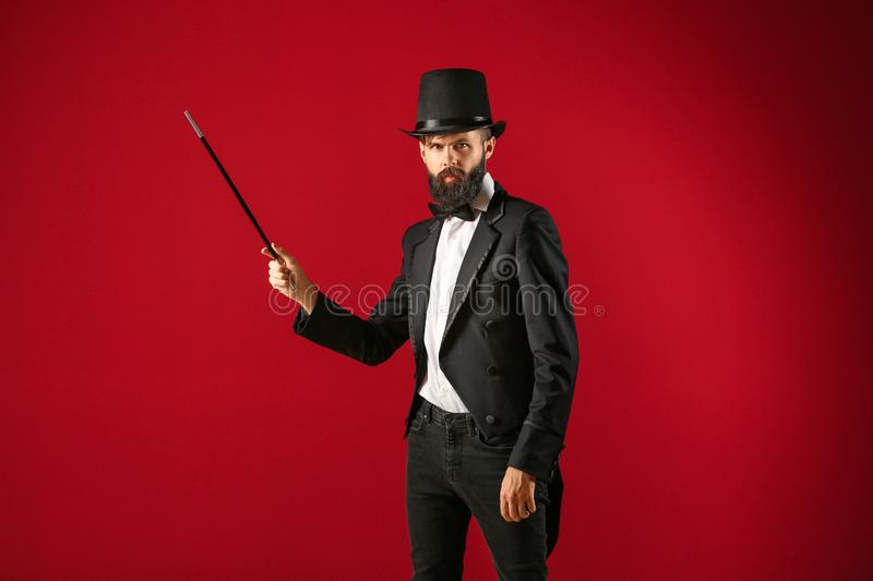 Male magician on color background stock photos