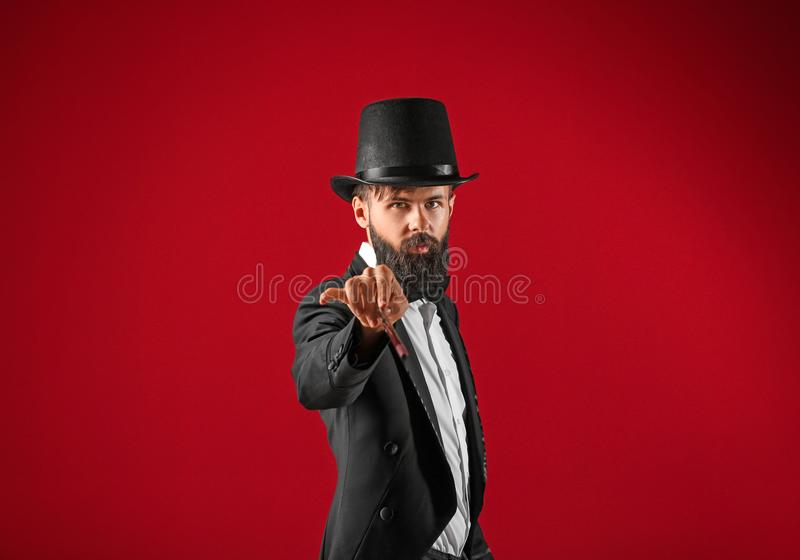 Male magician on color background royalty free stock image