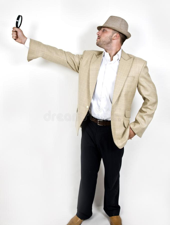 Male with magnifying glass stock image