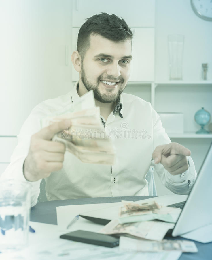 Male manager earning money effectively online stock photography
