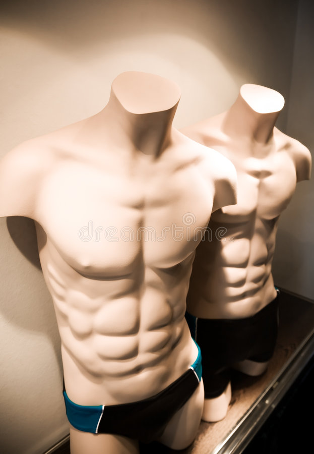 Male mannequin. In a shop window stock photos