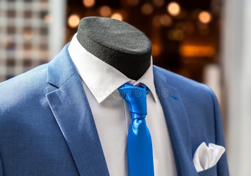 Male mannequin dressed in elegant men`s suit stock image