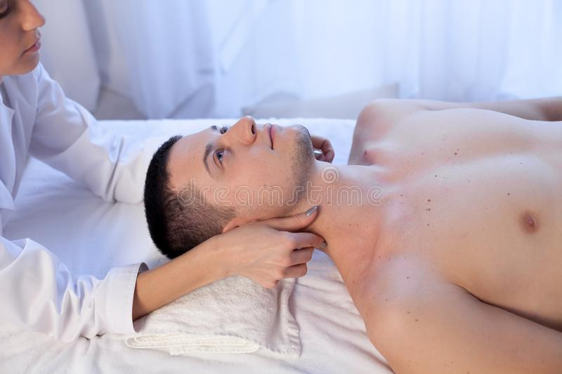 Male masseur doing massage therapy neck in Spa. 1 stock images