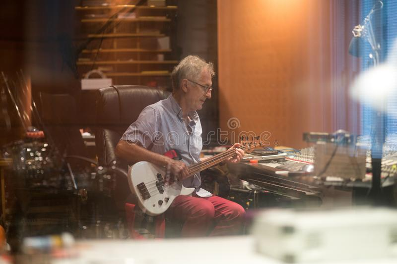 Male middle aged recording engineer in a recording studio stock photos
