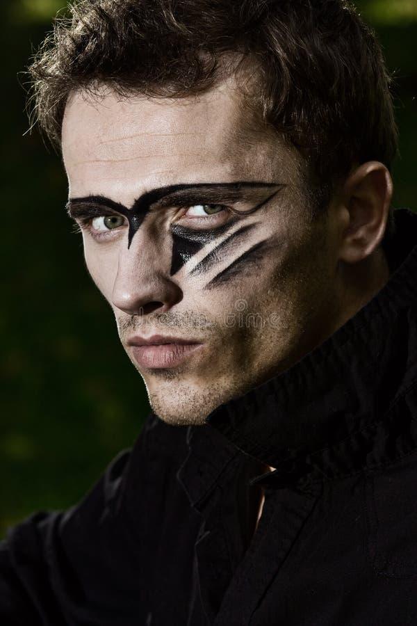 male militär porträttering för stilig hård makeup arkivfoton