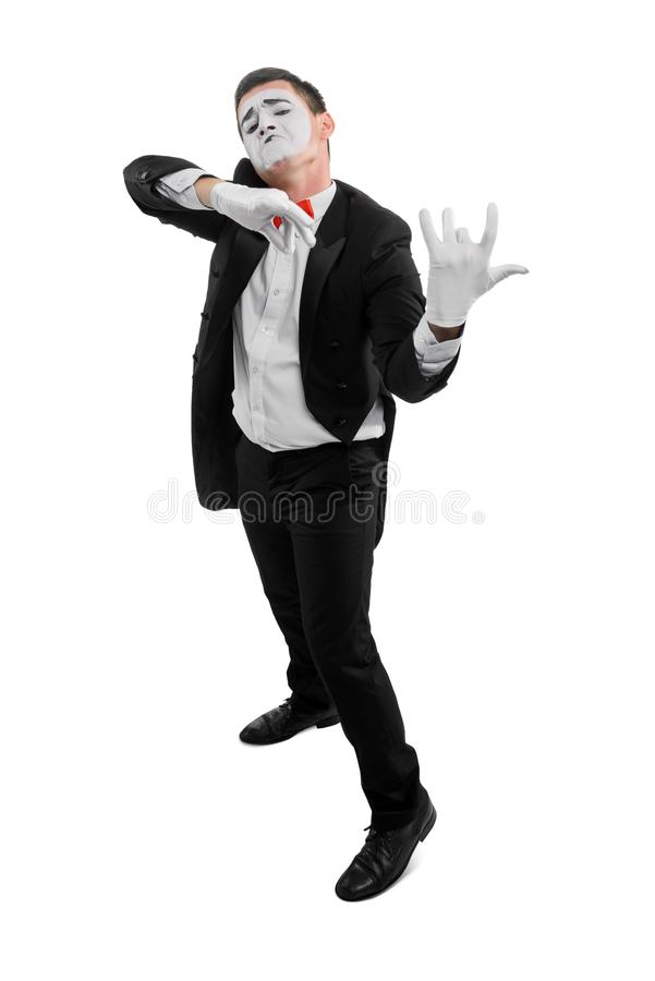 Male mime playing invisible violin stock photography