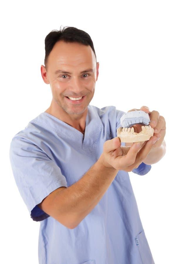 male mitt för åldrig caucasian tandläkare arkivbilder