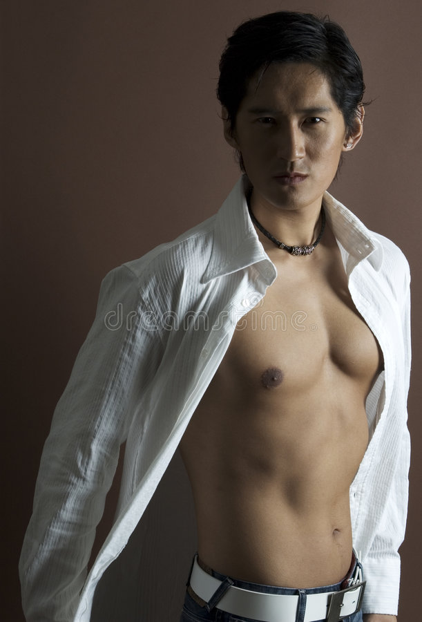Male Model 13. A cool asian model in an open white shirt royalty free stock images