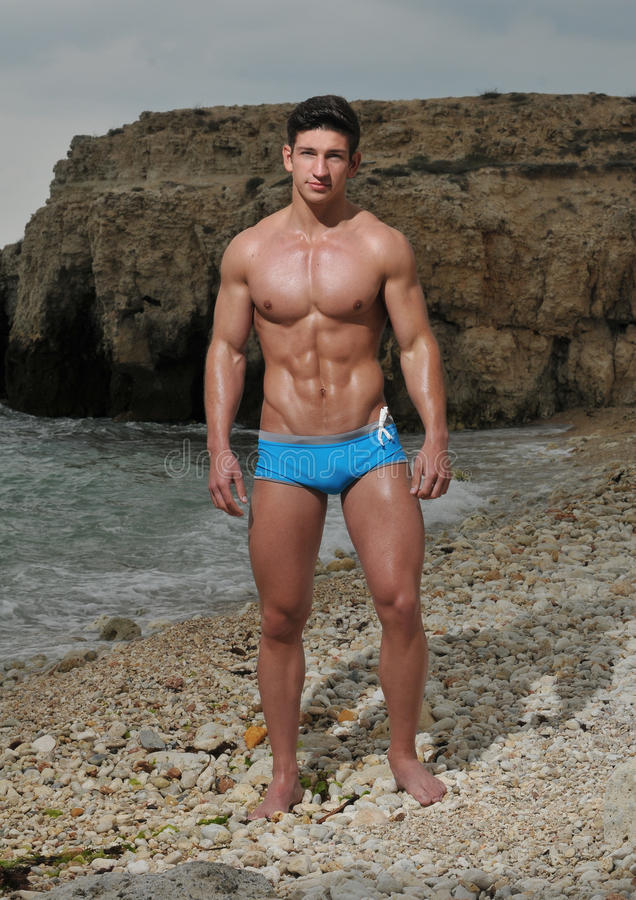 Male model on the beach stock photography