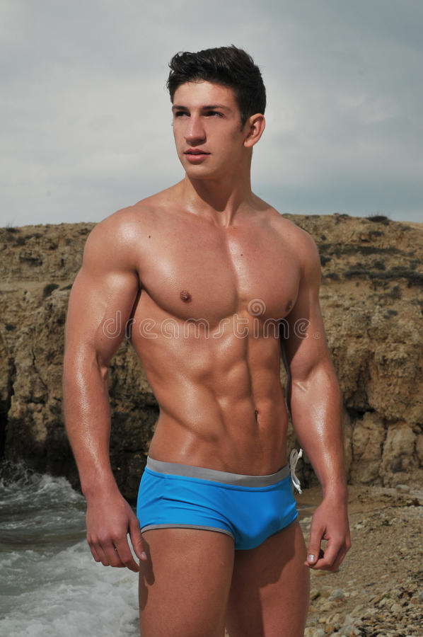 Male model on the beach stock image