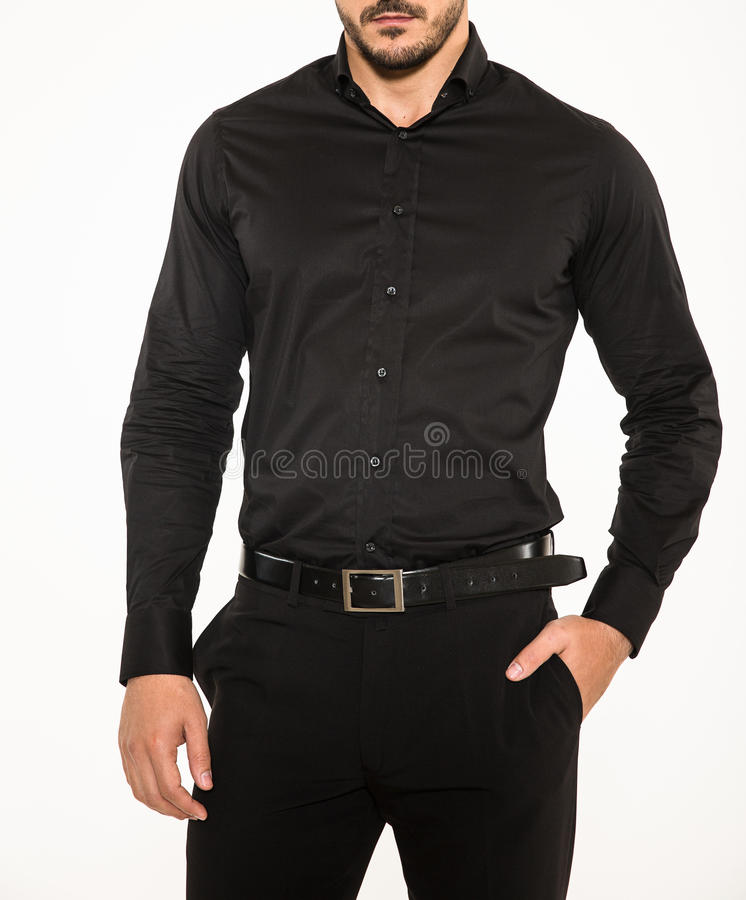Male model with elegant black pants, belt and black shirt. Male model wearing a modern elegant black shirt, black belt and pants stock photos