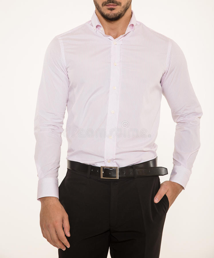 Male model with elegant black pants, belt and pink shirt. Male model wearing a modern elegant pink shirt, black belt and pants royalty free stock photos