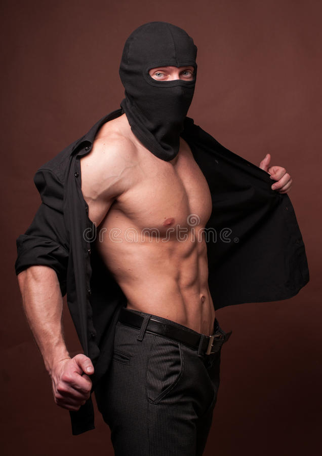 Male model in a mask stock photos
