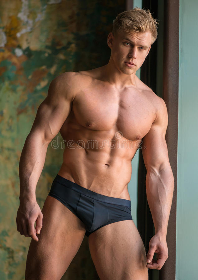 Male model. Muscled male model in studio