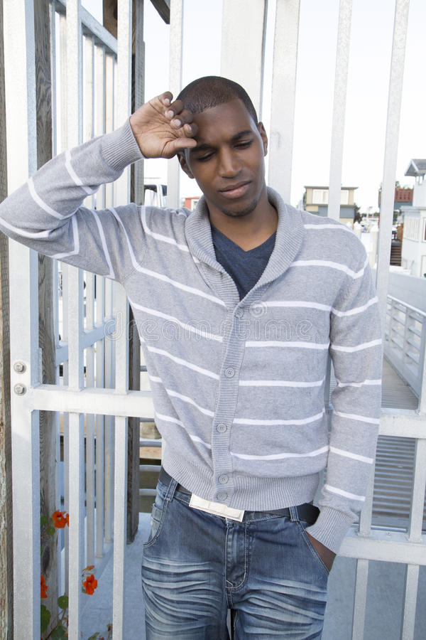 Male model sad hurt feelings looking depressed or thinking. Attractive black male model showing sad or hurt feelings or depressed emotions stock photography