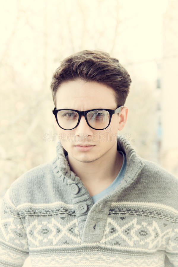 Male model in sweater with glasses outdoors royalty free stock photo