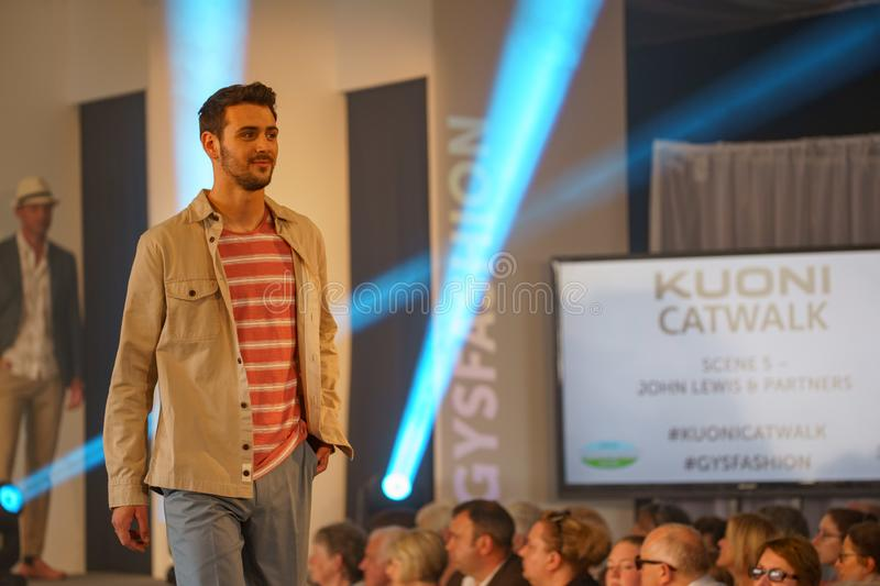 Male Model Wearing Casual Outdoor Clothes on a Catwalk. royalty free stock images