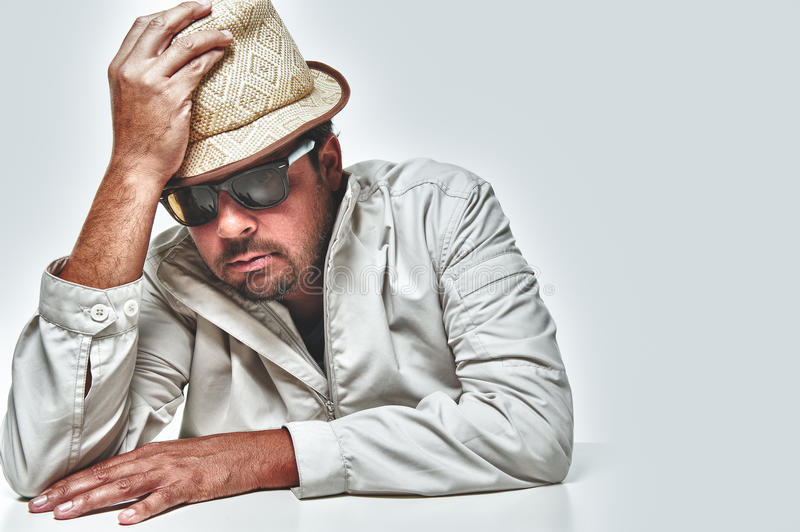 Male model wearing jacket hat and sunglasses royalty free stock photos