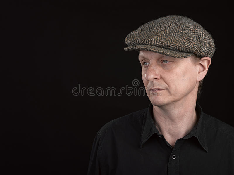 Male model wearing a patterned side hat stock images
