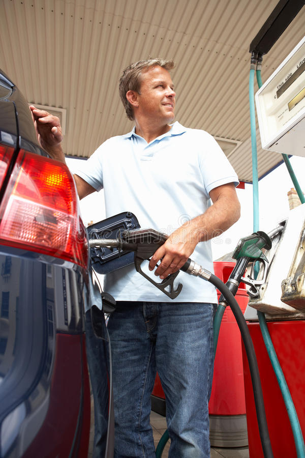 Male Motorist Filling Car With Petrol stock image
