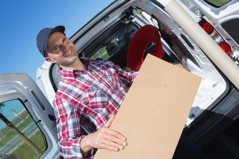 Male movers unloading from truck stock photo
