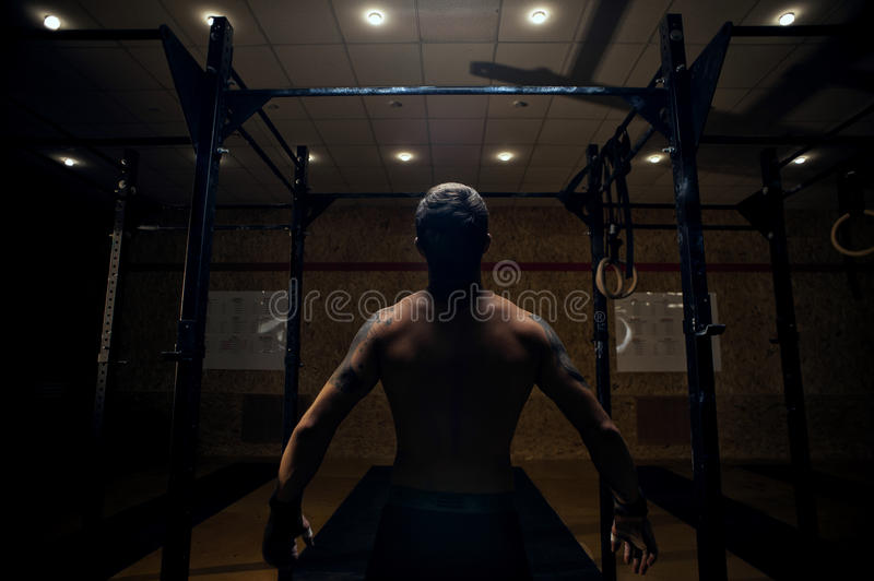Male muscular athlete preparing for pull up stock image