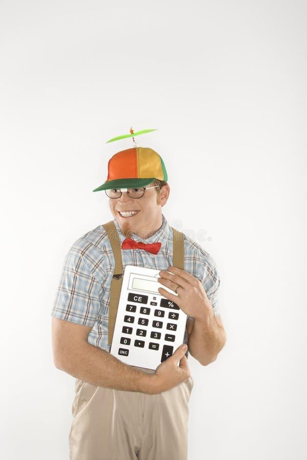 Male nerd holding calculator. royalty free stock image