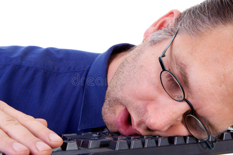 Male Nerdy Geek Fall Asleep On Keyboard Stock Photography