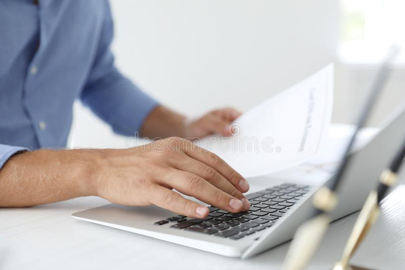 Male notary working with laptop at table. In office, closeup royalty free stock photo
