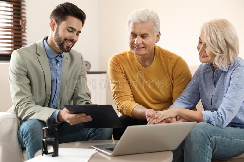 Male notary working with mature couple stock images