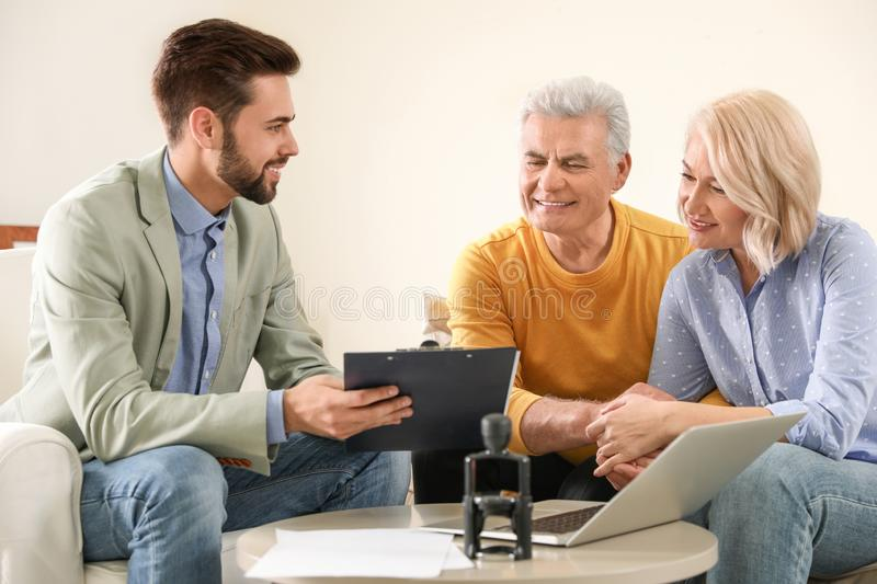 Male notary working with mature couple stock photos