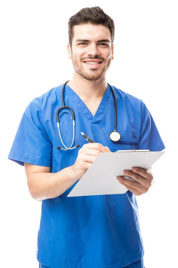 Male nurse reading a medical chart stock photos