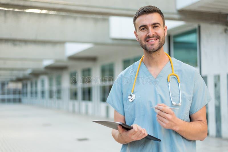 Male nurse with stethoscope. Male nurse vet outdoors smiling stock photo