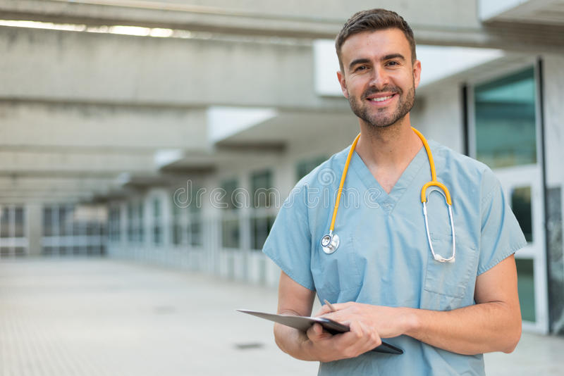 Male nurse with stethoscope. Male nurse vet outdoors smiling royalty free stock photo